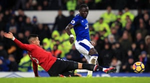 Manchester United's Marcos Rojo challenges Everton's Oumar Niasse.