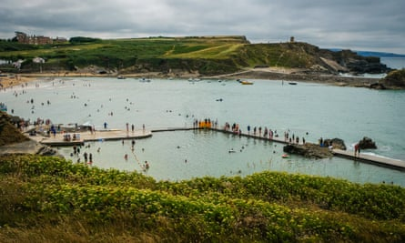 Go with the tide … people enjoying a dip at Bude tidal pool at Summerleaze beach, north Cornwall.