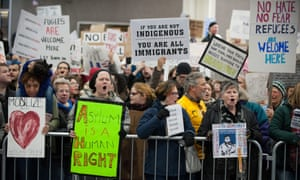 Demonstrators gather to protest against US President Trump's travel ban executive orders, outside of the international arrivals terminal at Philadelphia International Airport in Philadelphia, Pennsylvania, USA, 29 January 2017. EPA/TRACIE VAN AUKEN