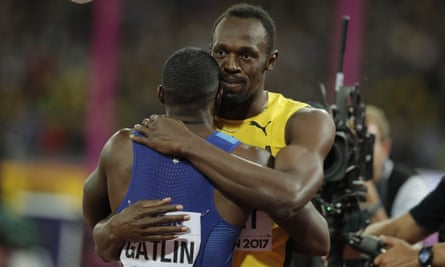 Usain Bolt embraces Justin Gatlin after the men's 100m final at the 2017 world championships