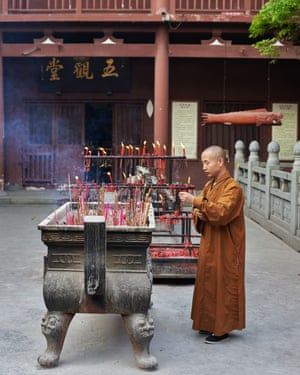 A monk at the nearby Yingtian Temple, a site of Buddhist devotion dating back to the Song Dynasty (960-1279). Since it was founded a thousand years ago the temple have been ravaged by fire numerous times, and was most recently destroyed in its entirety during the Cultural Revolution, China