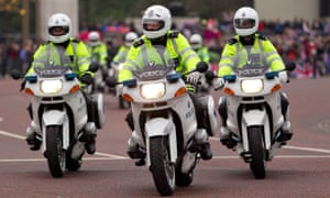 Motorbike outriders coming down the Mall