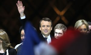 Emmanuel Macron arrives on stage at the Louvre after winning Sunday's presidential election
