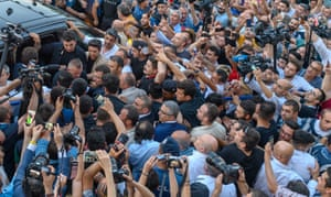 Istanbul, Turkey: Ekrem İmamoğlu, the newly elected mayor of Istanbul of the secular opposition Republican People's party (CHP), is surrounded by the press, his security detail and supporters as he approaches a vehicle following his victory speech