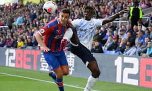 Moise Kean tussles with Scott Dann of Crystal Palace after coming on as a substitute in the opening game