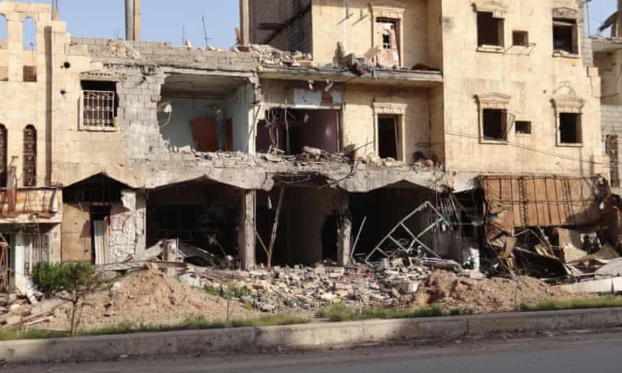 A view of damaged shops in Deir ez-Zor, taken in April 2014.