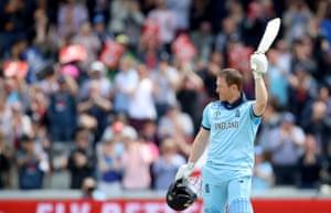 Eoin Morgan raises his bat after reaching a century.