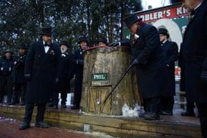 Groundhog Club President Bill Deeley knocks on the door to wake Punxsutawney Phil