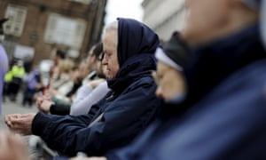 Worshippers pray outside the dumo in Turin.