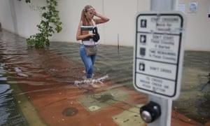 Yana Kibyakova walks along a flooded street in Miami Beach, Florida