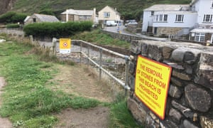 Sign at Crackington Haven warning of prosecution for removing stones from the shore.