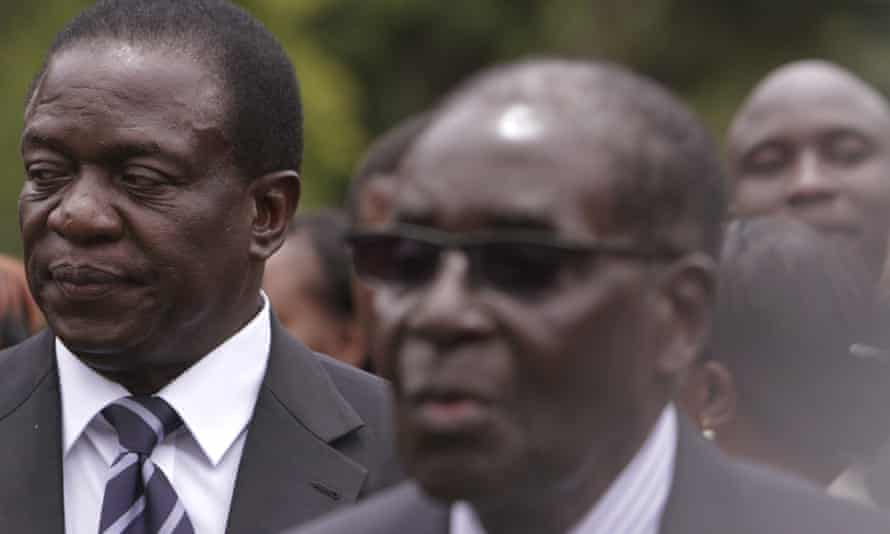 Emmerson Mnangagwa, left, stands behind Robert Mugabe in a 2014 swearing-in ceremony.