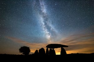 The Milky Way streaks over the Neolithic Pentre Ifan burial chamber in Pembrokeshire, Wales