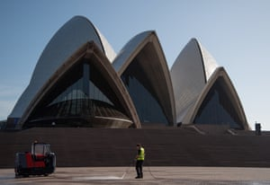 A lone worker cleans the front of the Sydney Opera House, Sydney, March 21, 2020.