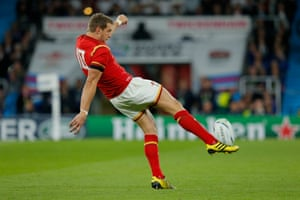Dan Biggar, seen here launching a kick upfield, slots a couple of penalties to keep Wales in the game, it's 22-18