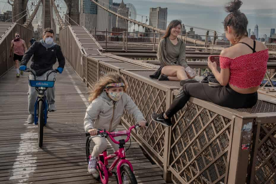 Bike rides and selfies on the Brooklyn, Bridge in Brooklyn, New York on Monday, May 18th.