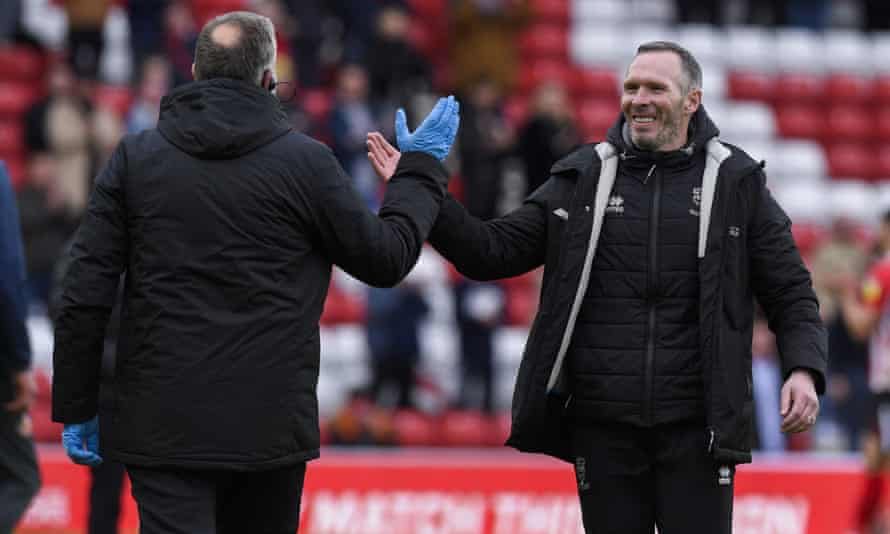 The Lincoln manager, Michael Appleton, celebrates after guiding his side to the League One play-off final.