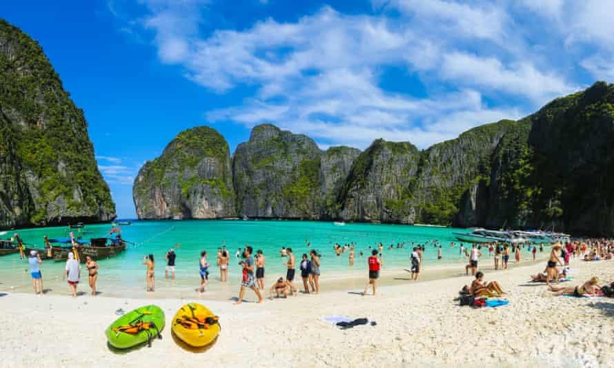 Tourists at Maya Bay, Thailand, beach on a sunny day.