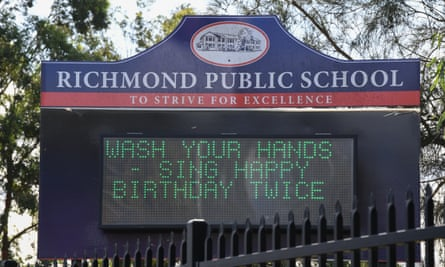 A sign outside a Sydney school asking children to sing happy birthday twice while washing their hands