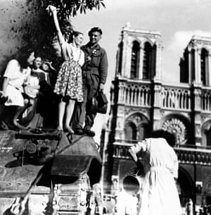 Parisian women join soldiers on a British tank in front of Notre Dame in the summer of 1944
