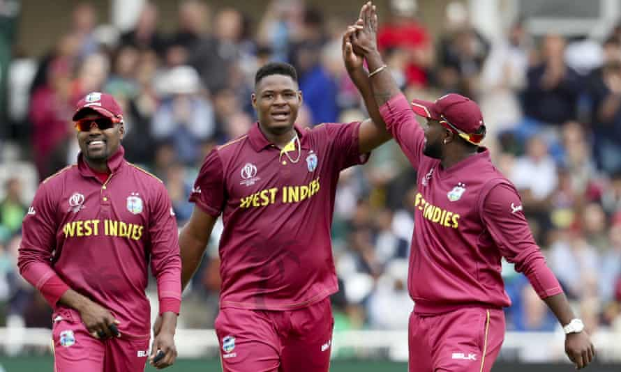 West Indies' Oshane Thomas (centre) celebrates with teammates after taking the wicket of Pakistan's Wahab Riaz.