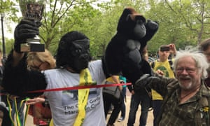 Tom Harrison is congratulated by Bill Oddie after crawling across the London Marathon finish line in a gorilla costume.