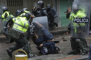 Bogota, Colombia Police clash with anti-government protesters in Bogota. Demonstrations have been triggered by proposed tax increases on public services, fuel, wages and pensions