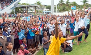 Fijians gather at the ANZ stadium in Suva to watch their rugby sevens team win gold against Britain on the big screen.