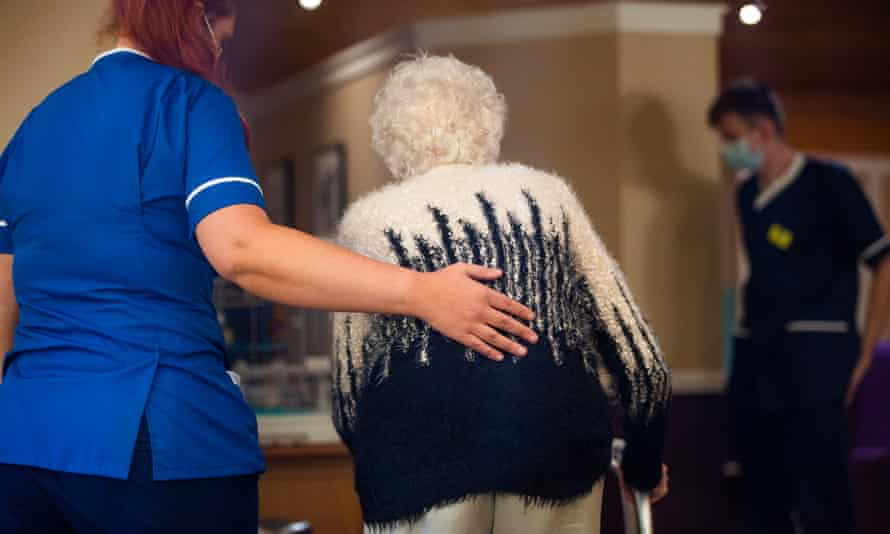 Staff helping a resident in a care home