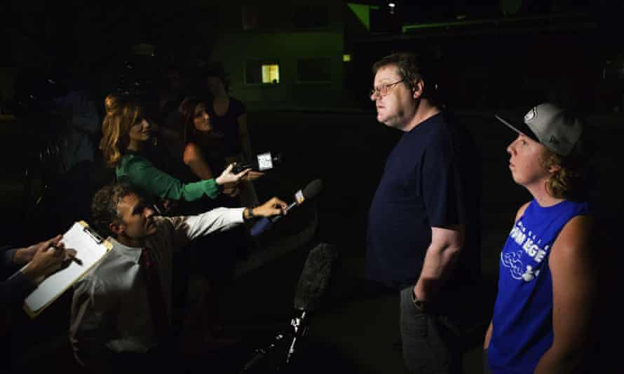 """David Veatch, the father of Autumn Veatch, 16, along with family friend Chelsey Clark, right, speak to the media outside the Three Rivers Hospital in Brewster, Wash. on Monday, July 13, 2015. """"Survivorman should be proud of her,"""" Veatch said"""