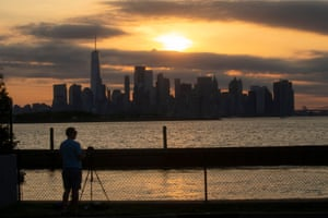 The New York skyline as the moon partially covers the sun during the partial solar eclipse, as seen from Jersey City, New Jersey