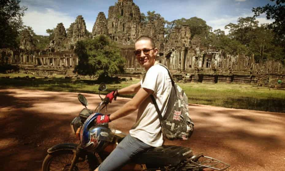 Reader Chris Pickles on his old Honda at Angkor Wat, Cambodia