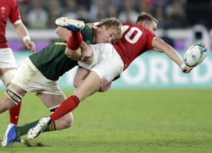 Wales' Dan Biggar, right, passes while being tackled by South Africa's Pieter-Steph du Toit, but it's forward.