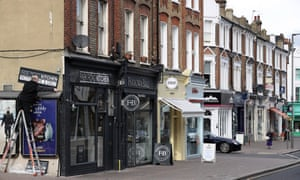 A row of shops on Northcote Road in Battersea, south London