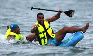 England's Joe Cokanasiga (right) and Anthony Watson find paddleboarding not quite as easy as it looks during some down time at England's pre-World Cup training camp in Miyazaki.