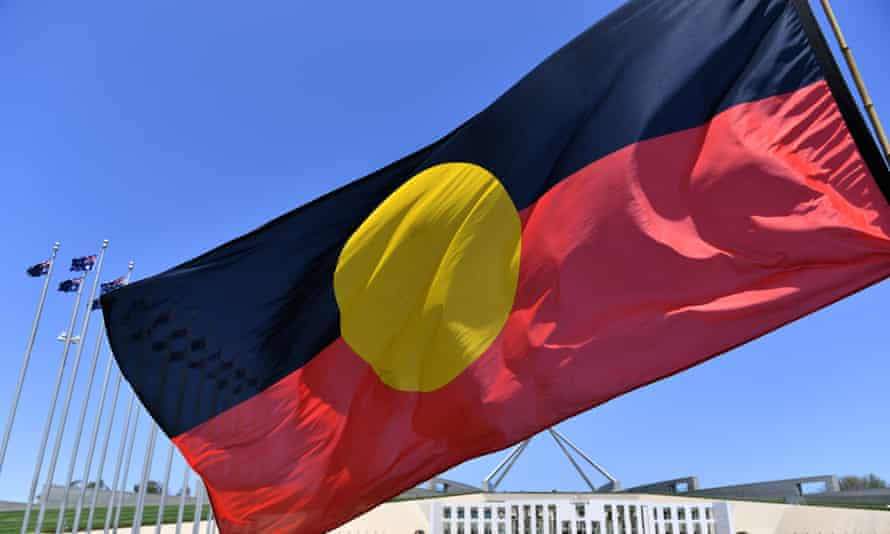 The Aboriginal flag with Parliament House in Canberra behind