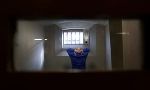 A man in a prison cell