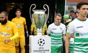 The New Saints and opponents Apoel Nicosia pass the Champions League trophy ahead of their July 2016 qualifier at Park Hall.