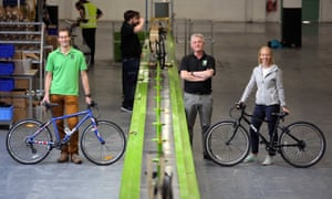 Frog Bikes owners Jerry and Shelley Lawson with general manager Robert Mason, centre, on the production line in Pontypool, Wales