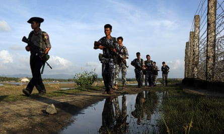 Myanmar police officers patrol the border between Myanmar and Bangladesh in Maungdaw, Rakhine State, in this photo from October.