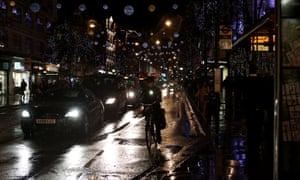 Vehicles amid the Christmas lights of Oxford Street, one of the most polluted streets in the world.