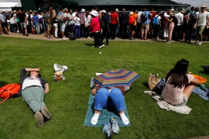 Wimbledon, UK: Spectators take a rest from all the action on day two of the tennis championships.