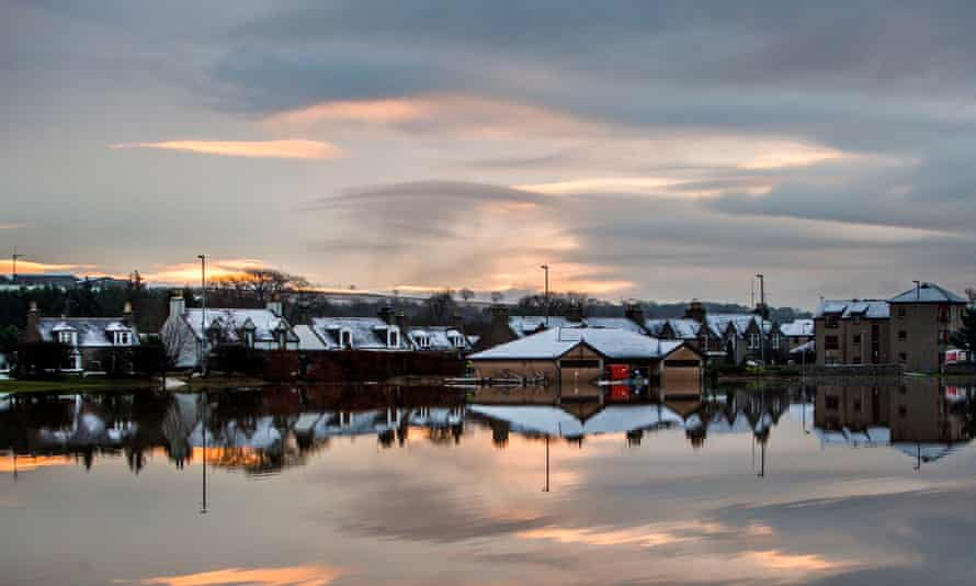 Houses are reflected in flood water at dawn in Port Elphinstone, near Aberdeen on 8 January.