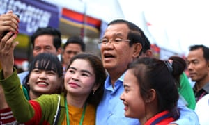 Cambodian prime minister Hun Sen (centre) is seeking re-election as his government cracks down on 'fake news'.