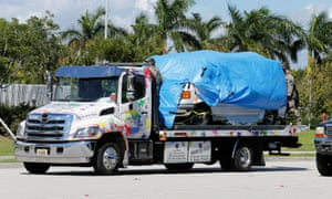 A white van seized during an investigation into a series of parcel bombs is towed into FBI headquarters in Miramar, Florida.