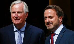Luxembourg's PM, Xavier Bettel, right, welcomes the EU's chief Brexit negotiator, Michel Barnier, before a meeting with Boris Johnson in Luxembourg.