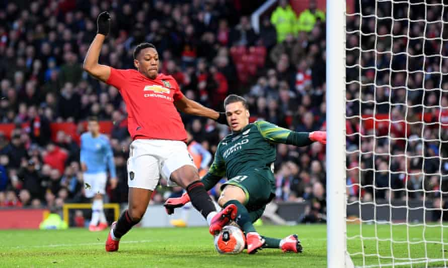 Anthony Martial, left, and Ederson, right, battle for the ball.