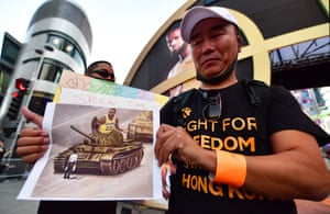 Anti-Chinese Communist Party activists protest outside Staples Center, home of the LA Lakers and Clippers, in the wake of the NBA's confrontation with China