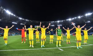 Ukraine players gesture to fans after the match.