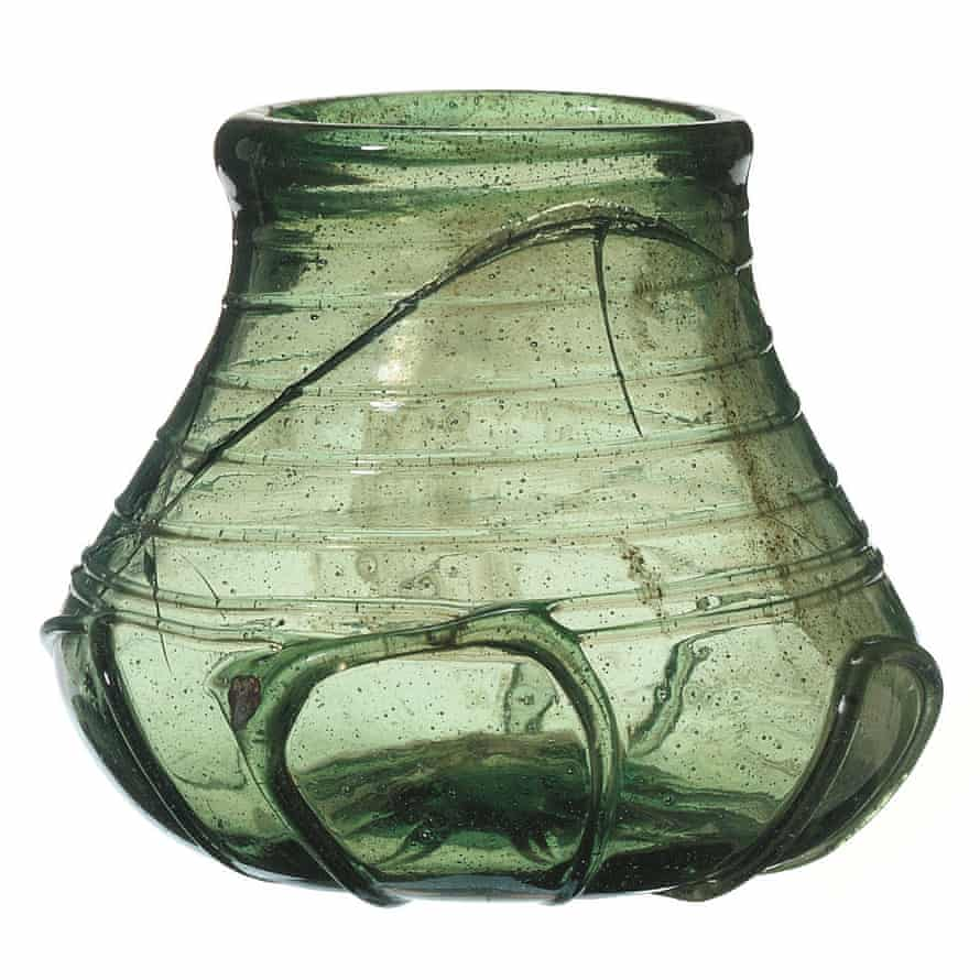 A decorated green glass beaker from the burial chamber